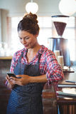 Waitress using a smartphone Stock Images