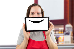 Waitress with a virtual smile at the coffee shop Royalty Free Stock Photography