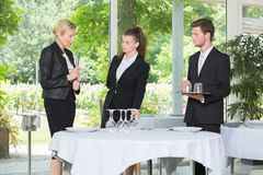 Waitress and waiter at catering service in restaurant royalty free stock photography