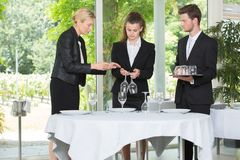 Waitress and waiter cleaning glasses in restaurant royalty free stock photo