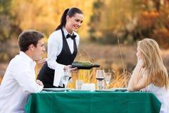 Waitress wine couple Stock Images