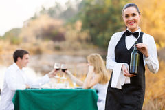 Waitress wine customers Stock Images