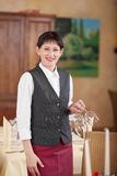 Waitress With Wineglasses In Restaurant Stock Images