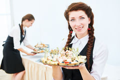 Waitress woman at restaurant catering event Stock Photos