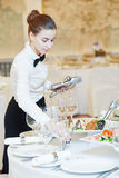 Waitress woman in restaurant Stock Images