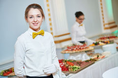 Waitress woman in restaurant. Waitress occupation. Young women with food on dishes servicing in restaurant during catering the event Royalty Free Stock Image