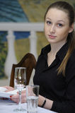 Waitress at work. Waitress wipes the dishes in restaurant Stock Photography