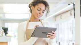 Waitress working with portable tablet. stock footage