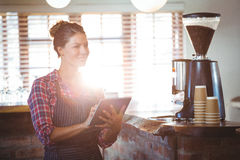 Waitress writing in a book Royalty Free Stock Photo