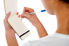 Waitress writing down customers order Royalty Free Stock Photo