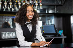 Waitress writing down an order Royalty Free Stock Photography