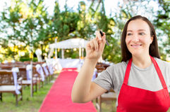 Waitress writing on the whiteboard at the wedding Royalty Free Stock Photo