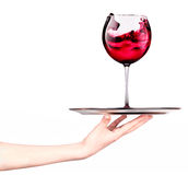 Waitresses holding tray with glass of red wine Stock Photos
