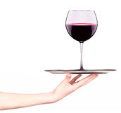Waitresses holding tray with glass of red wine Royalty Free Stock Photography