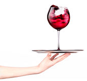 Waitresses holding tray with glass of red wine Stock Photo