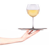Waitresses holding tray with glass of white wine Stock Photo