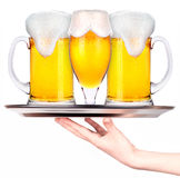 Waitresses holding tray with light beer isoalted Royalty Free Stock Image