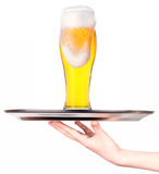 Waitresses holding tray with light beer isoalted Royalty Free Stock Photos