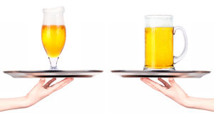 Waitresses holding tray with light beer isoalted Stock Photography