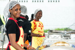 Waitresses in restaurants. Abidjan, Ivory Coast, September 11, 2016: Young women waitresses to restore grilling feast of Abidjan. Standing behind different Stock Photos