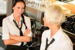 Waitresses talking gossiping in break cafe women. Smiling friends bar Royalty Free Stock Photo
