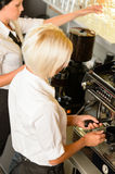 Waitresses at work make coffee machine cafe Royalty Free Stock Photo