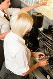 Waitresses at work make coffee machine cafe. Women espresso machine Royalty Free Stock Photo