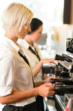 Waitresses at work make coffee machine cafe Stock Image