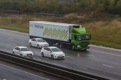 Waitrose lorry in motion. Redbourn, UK - September 21, 2017: Lorry belonging to the British Waitrose Supermakret in motion on the motorwey M1, in a rainy weather Stock Photos