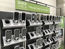 Scan hansets of Waitrose store, London royalty free stock image