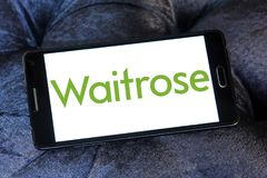 Waitrose Supermarkets chain logo. Logo of Waitrose Supermarkets chain on samsung mobile. Waitrose is a chain of British supermarkets, which forms the food retail Stock Image