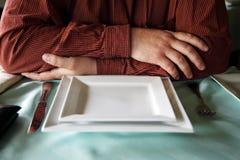 Waits food at restaurant Royalty Free Stock Image