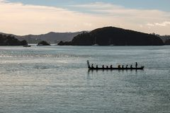 Waka Maori Canoe at Sunrise on Waitangi Day, New Zealand stock photography