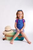 Wakacyjna walizka i kapelusz Zdjęcia Stock