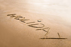 Wakacyjny słowo pisać na piaska pojęcia abstrakcie Obrazy Stock