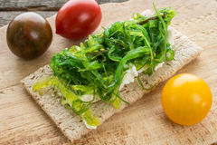 Wakame and ricotta garnished on a crispbread Stock Images