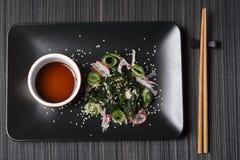 Wakame salad with sesame seeds Stock Photo