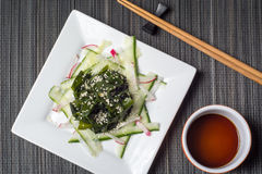 Wakame salad with sesame seeds Stock Photos