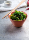 Wakame salad. Small bowl with wakame salad garnished with sesame Royalty Free Stock Photo