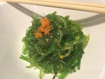 Wakame Seaweed Salad. Wakame is a sea vegetable, or edible seaweed. It has a subtly sweet flavour and is most often served in soups and salads. Wakame is a rich royalty free stock image