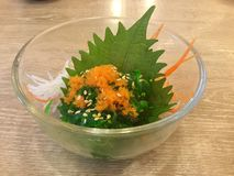 Wakame seaweed salad with fish roe. Wakame is a sea vegetable, or edible seaweed. It has a subtly sweet flavour and is most often served in soups and salads royalty free stock photo