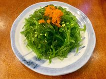Wakame seaweed salad with fish roe. Wakame is a sea vegetable, or edible seaweed. It has a subtly sweet flavour and is most often served in soups and salads stock images
