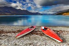 Wakatipu Lake, New Zealand. Red kayaks at the lakeside, Wakatipu Lake, New Zealand Stock Images