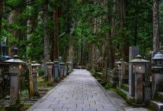 Okunoin Cemetery on Mt. Koya in Japan. Wakayama, Japan - Nov 24, 2016. Path of Okunoin Cemetery on Mt. Koya in Wakayama, Japan. Okunoin, a mausoleum, surrounded Stock Photos