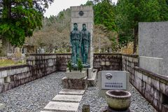 Tombstones at Okunoin Cemetery. Wakayama, Japan - Nov 24, 2016. Tombstones with monument at Okunoin Cemetery on Mt. Koya Koyasan in Wakayama, Japan Royalty Free Stock Image