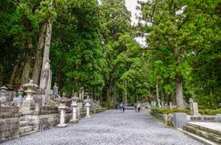 Tombstones at Okunoin Cemetery. Wakayama, Japan - Nov 24, 2016. Tombstones with pine forest at Okunoin Cemetery on Mt. Koya Koyasan in Wakayama, Japan Stock Image