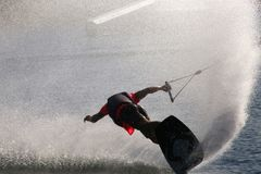 Wake Boarder Spray. A wake boarder being pulled by cable creates a gigantic plume of spray at Quiet Waters Park, Deerfield Beach, Florida Royalty Free Stock Images