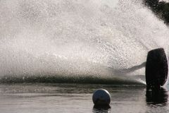 Wake Boarder Spray. A wake boarder being pulled by cable creates a gigantic plume of spray at Quiet Waters Park, Deerfield Beach, Florida Royalty Free Stock Photo