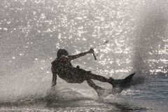 Wake Boarder Spray. A wake boarder being pulled by cable creates a gigantic plume of spray at Quiet Waters Park, Deerfield Beach, Florida Stock Photos