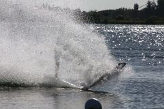 Wake Boarder Spray. A wake boarder being pulled by cable creates a giant plume of spray at Quiet Waters Park, Deerfield Beach, Florida Royalty Free Stock Image